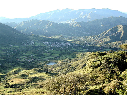 Vilcabamba village, nestled between tall Andean peaks