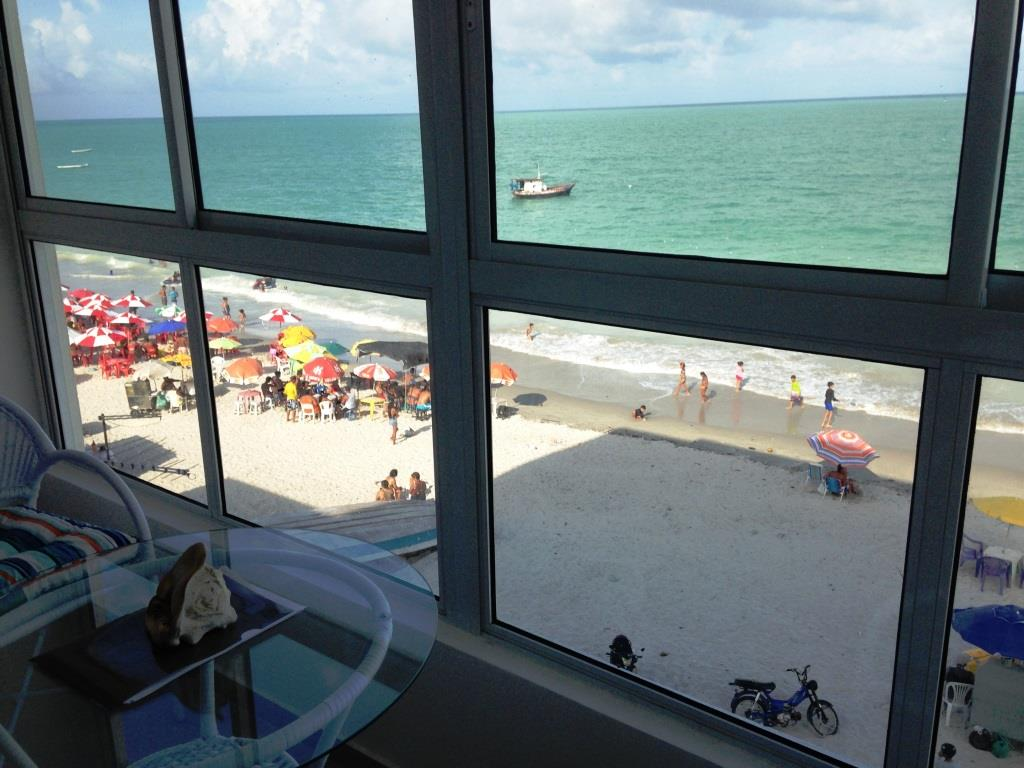 A window view of the beachfront from the interior of a Morado do Sol condo