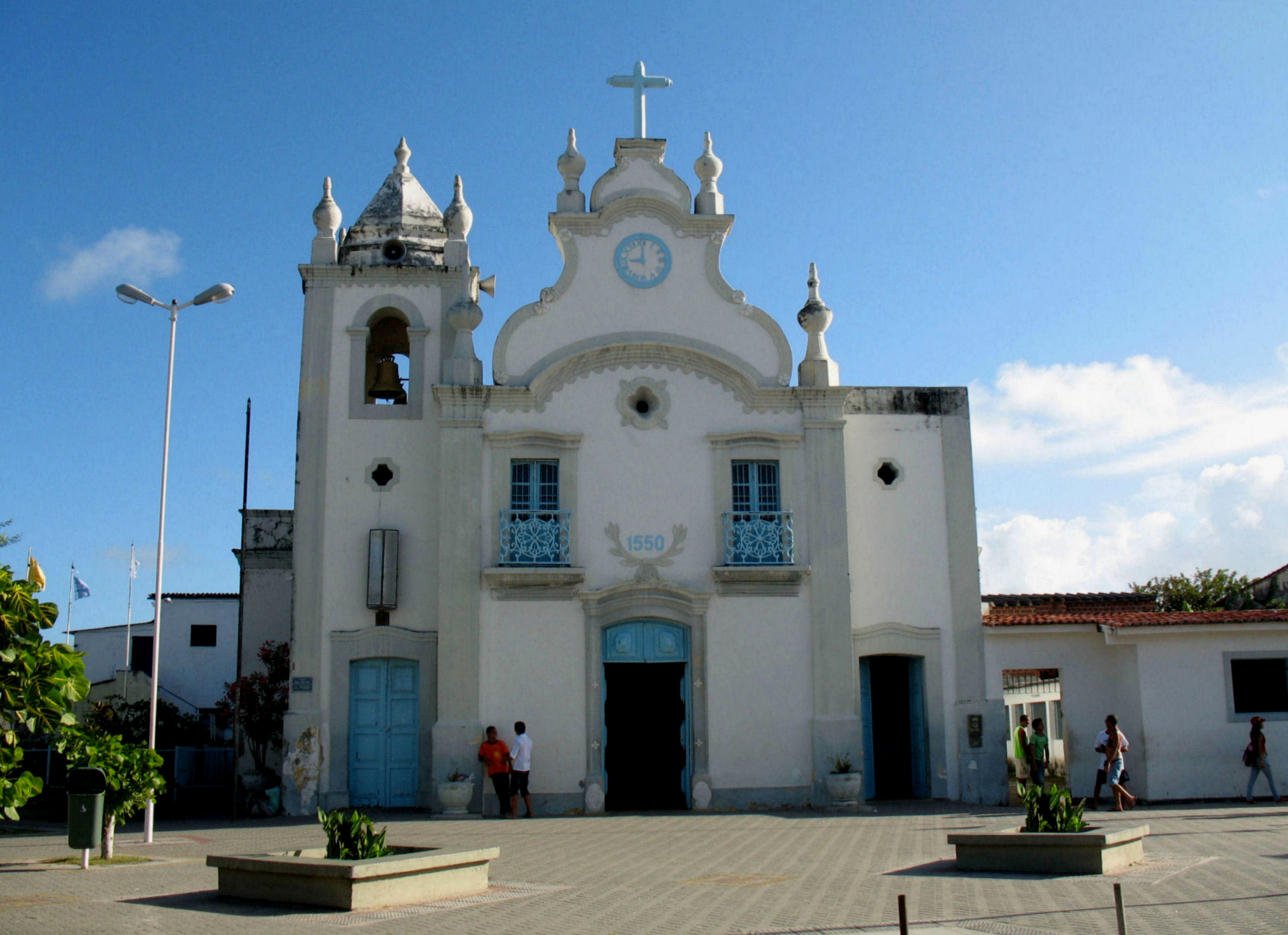 A view of Itamaraca's local church from the front of the building in a town square