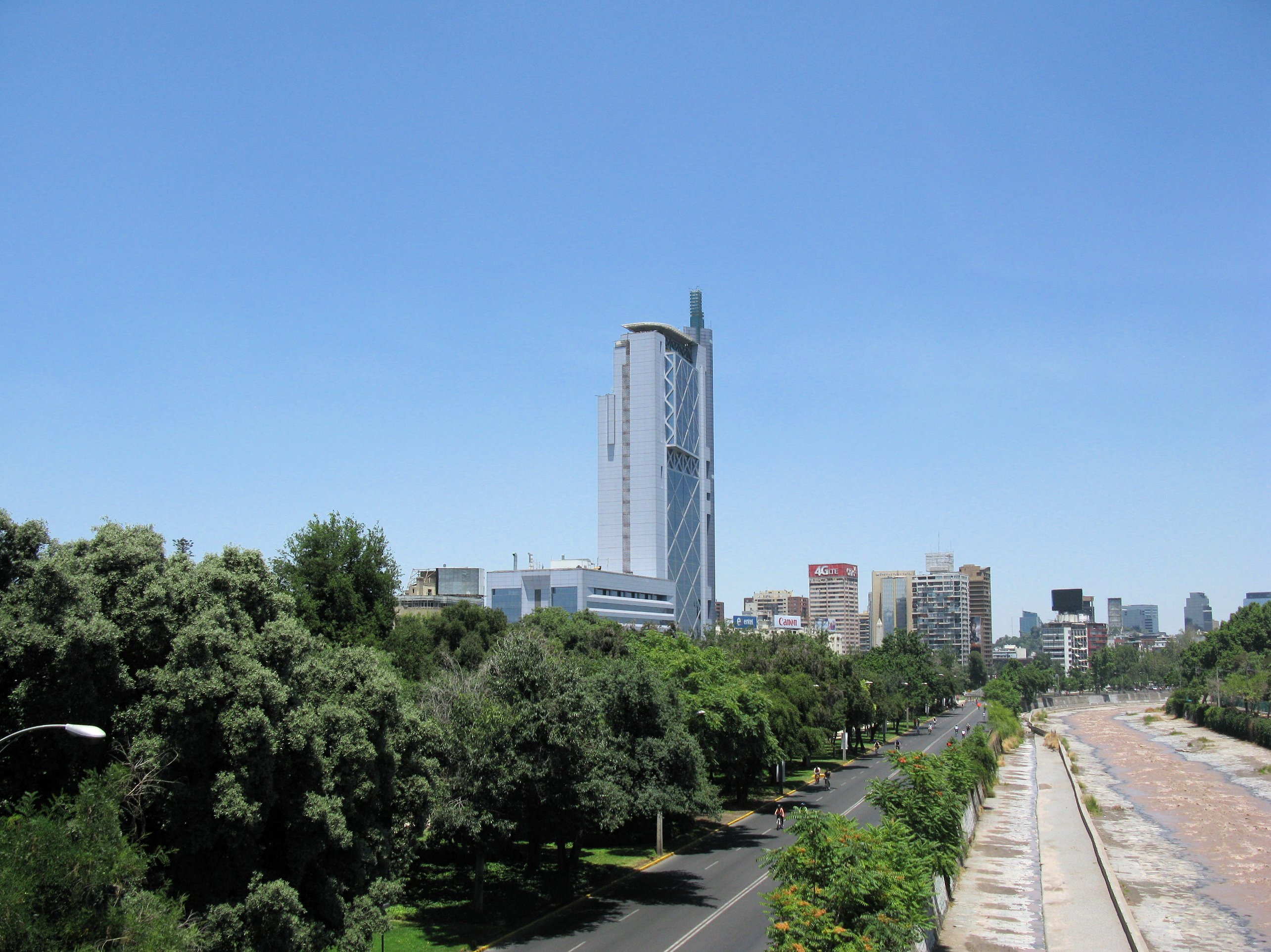 Looking west, Providencia's trees provide a lush  foreground for Santiago's Torre Telefonica and its downtown
