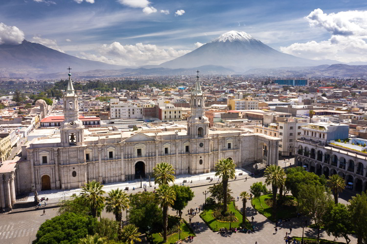 Aerial drone view of Arequipa main square and cathedral church, with the Misti volcano as background.