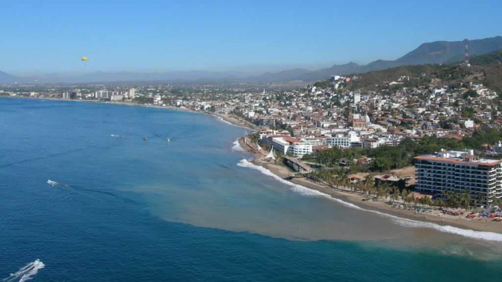A boat races across the sea at Puerto Vallarta Bay