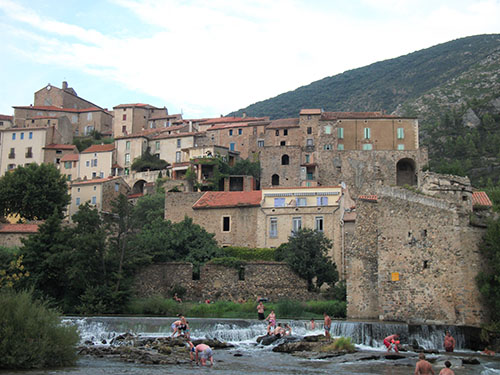 The village of Roquebrun and its popular river beach