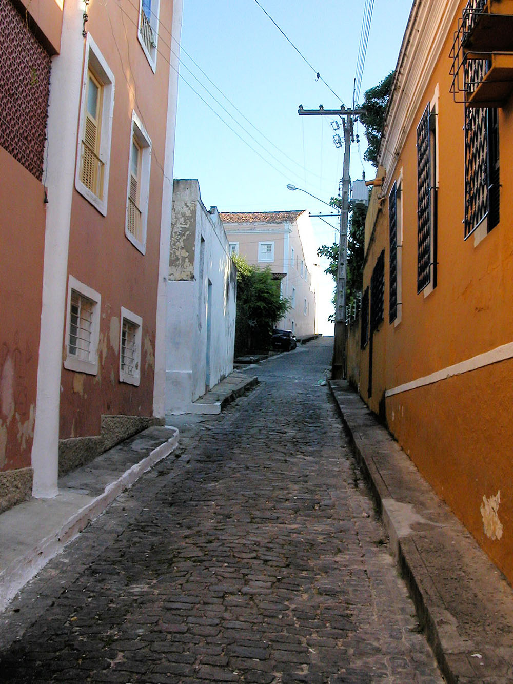 Colorful buildings in a cobblestone alleyway in Olinda Brazil