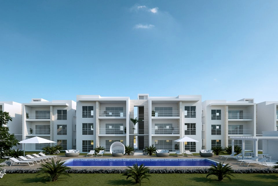 white three story condos with long pool nad lounge chairs