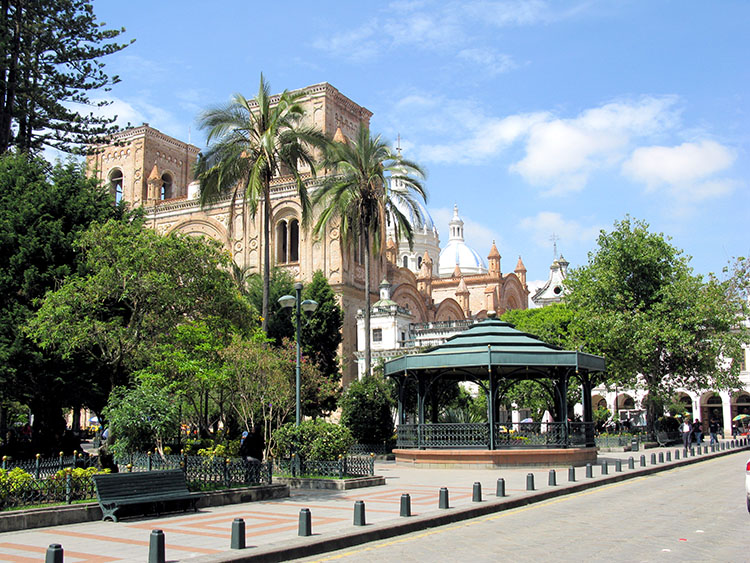 a plaza with a cathedral and gazebo in Cuenca