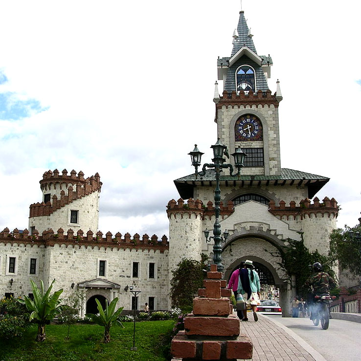 the clock tower, castle-like city gates of Loja Ecuador