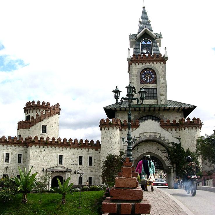 the clock tower, castle-like city gates of Loja Ecuador