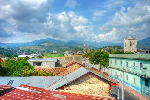 Matagalpa, Nicaragua. View over rooftops to the mounitains. Blue sky and lush green Nicuraguan countryside