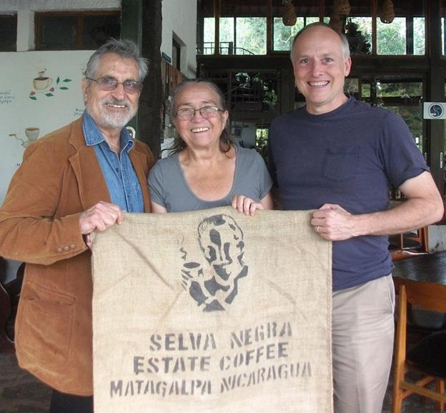 Mike Cobb with the owners of Selva Negra Coffee Estate. They are posing with one of their sacks which is used to store the coffee beans in.