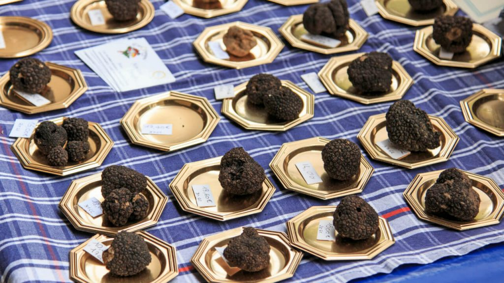 black truffles on gold plates