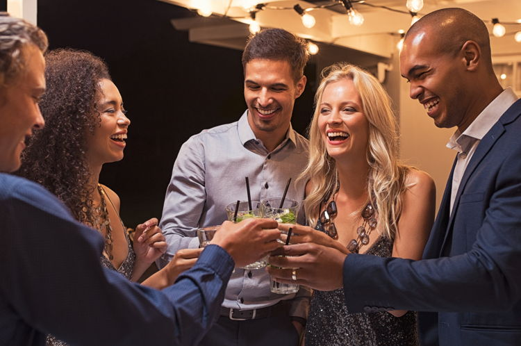 people laughing at a cocktail party