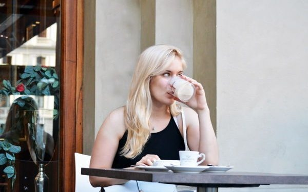 blonde girl drinking coffee