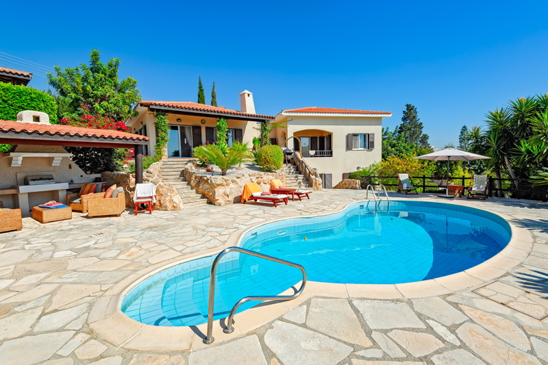 Private swimming pool and patio area outside Cyprus villa.