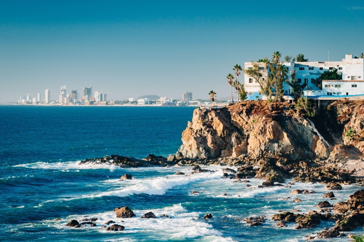 View of cliffs, the Pacific ocean and the touristic part of Mazatlan, Sinaloa, Mexico