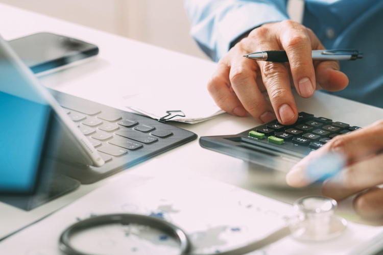 Man calculating costs